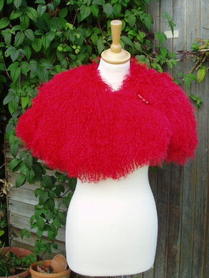 Red Mongolian Sheepskin Shrug Fastened with a Toggle
